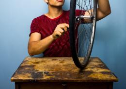 Man fixing bicycle tyre